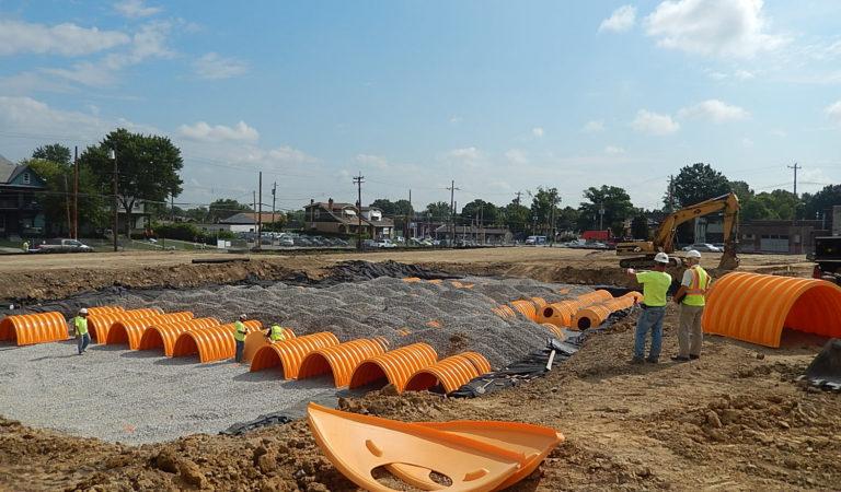 Excavating - orange pipe - horizontal 21w x 16h